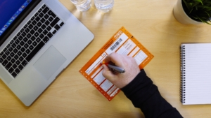 TNT promotional film behind the scenes photo of invoice being filled