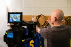 Tv advert behind the scenes photo of tools being hung